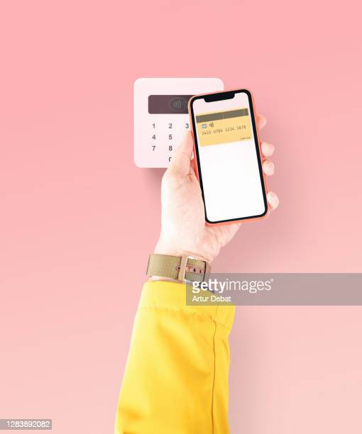 paying to wireless pop reader using mobile phone with contactless credit card. - smooth stock pictures, royalty-free photos & images