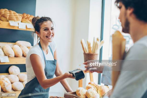 paying with credit card for a baguette - credit card reader stock pictures, royalty-free photos & images