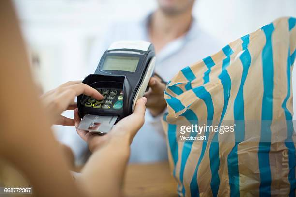 Paying with credit card in a shop