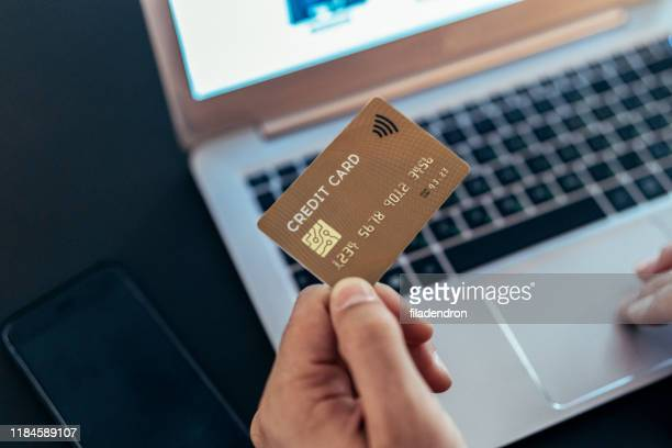 paying with credit card - money transfer stock pictures, royalty-free photos & images