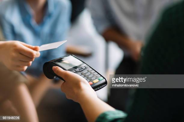 paying with credit card - credit card reader stock pictures, royalty-free photos & images
