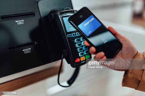 paying with mobile phone at supermarket - telephone stock pictures, royalty-free photos & images