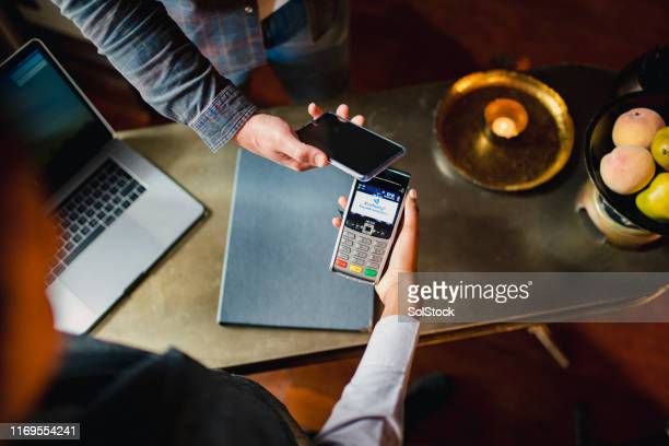 paying with my mobile phone - paying stock pictures, royalty-free photos & images