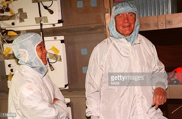 Payload Specialists Chiaki Mukai with the National Space Development Agency of Japan and John H Glenn Jr senator from Ohio take part in middeck...