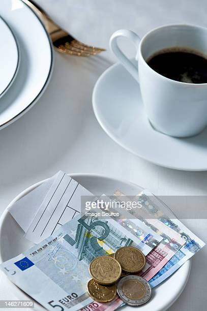 payment and coffee on restaurant table - five euro banknote stock photos and pictures