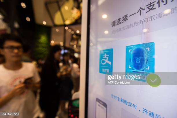 A payment icon is seen on the screen of the Smile to Pay system at a KFC fast food restaurant in Hangzhou in China's eastern Zhejiang province on...