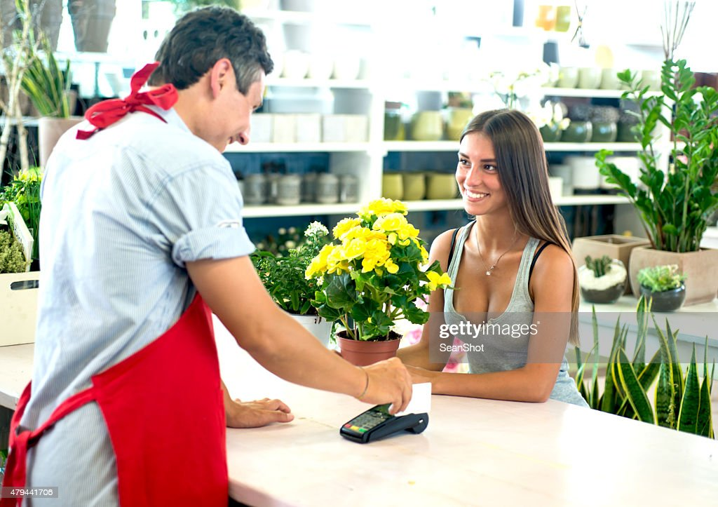 Payment with a Credit Card at The Florist : Stock Photo
