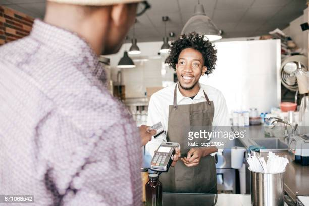 payment with credit card - afro caribbean ethnicity stock pictures, royalty-free photos & images