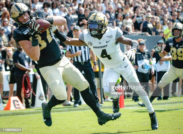 Payne Durham of the Purdue Boilermakers catches a touchdown pass in the end zone as Randall Haynie of the Vanderbilt Commodores defends at Ross-Ade...