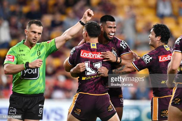 Payne Haas of the Broncos celebrates scoring a try with team mate Jordan Riki during the round 20 NRL match between the Brisbane Broncos and the...
