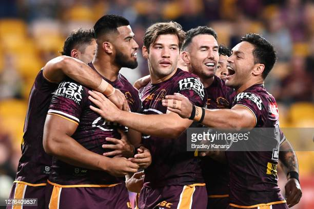 Payne Haas of the Broncos celebrates scoring a try with team mates during the round 20 NRL match between the Brisbane Broncos and the North...