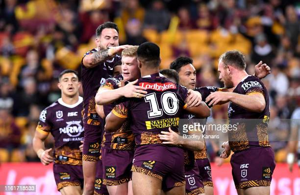 Payne Haas of the Broncos is congratulated by team mates after scoring a try during the round 17 NRL match between the Brisbane Broncos and the New...