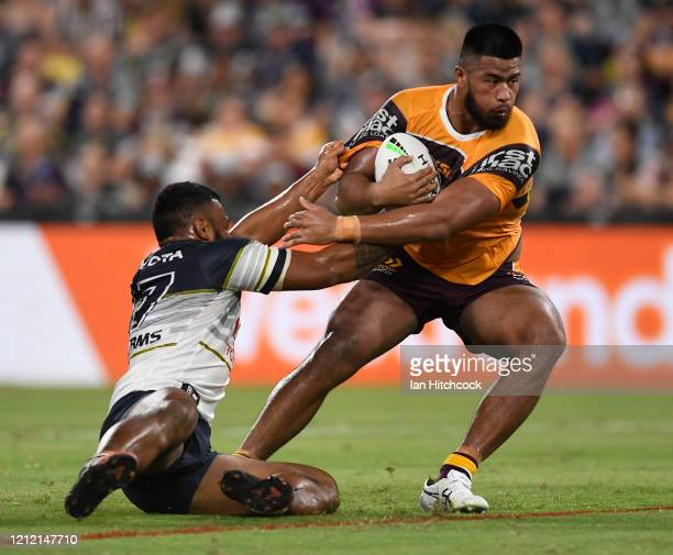 Payne Haas of the Broncos is tackled by Jamil Hopoate of the Cowboys during the round 1 NRL match between the North Queensland Cowboys and the...