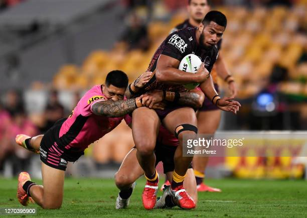 Payne Haas of the Broncos is tackled during the round 17 NRL match between the Brisbane Broncos and the Penrith Panthers at Suncorp Stadium on...
