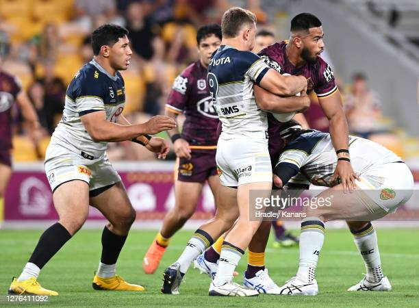Payne Haas of the Broncos is tackled during the round 20 NRL match between the Brisbane Broncos and the North Queensland Cowboys at Suncorp Stadium...