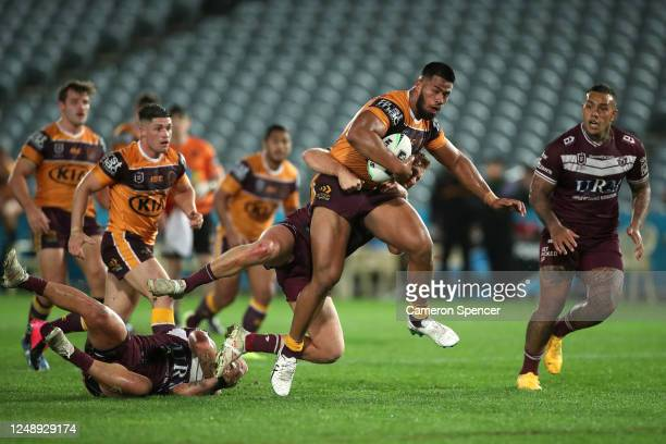 Payne Haas of the Broncos is tackled during the round five NRL match between the Manly Sea Eagles and the Brisbane Broncos at Central Coast Stadium...