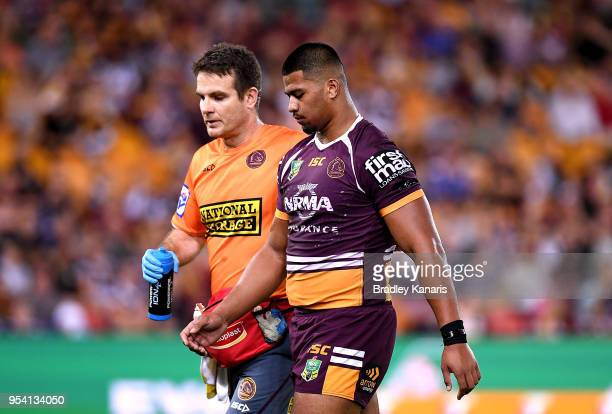Payne Haas of the Broncos is taken from the field injured during the round nine NRL match between the Brisbane Broncos and the Canterbury Bulldogs at...