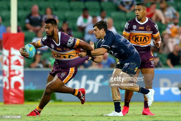 Payne Haas of the Broncos tries to get past the cowboys tackler during the match between the Cowboys and Broncos from Day 1 of the 2020 NRL Nines at...