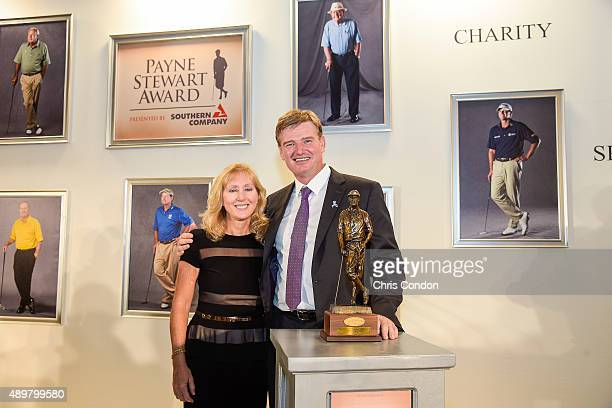 Payne Stewart Award recipient Ernie Els poses with the late Stewart's wife Tracey Stewart an award ceremony held following practice for the TOUR...