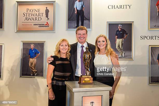 Payne Stewart Award recipient Ernie Els poses with the late Stewart's wife Tracey Stewart and their daughter Chelsea an award ceremony held following...