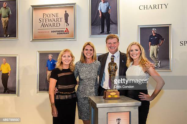 Payne Stewart Award recipient Ernie Els poses with the late Stewart's wife Tracey Stewart his wife Liezl Els and Chelsea Stewart at an award ceremony...