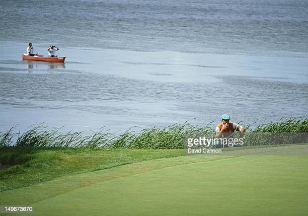 Payne Stewart of the United States considers his next shot beside the lake during the US Open Golf Tournament on 14th June 1991 at the Hazeltine...