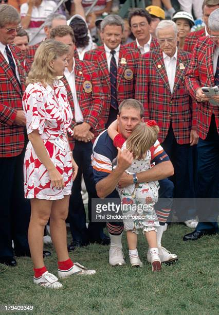 Payne Stewart of the United States hugs his daughter Chelsea whilst his wife Tracey looks on after winning the US PGA Championship held at the Kemper...
