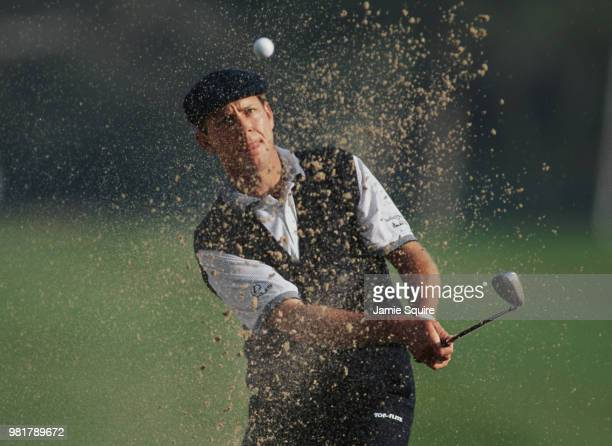 Payne Stewart of the United States keeps his eye on the ball as he hits out of the bunker during the Mercedes Championships golf tournament on 6...