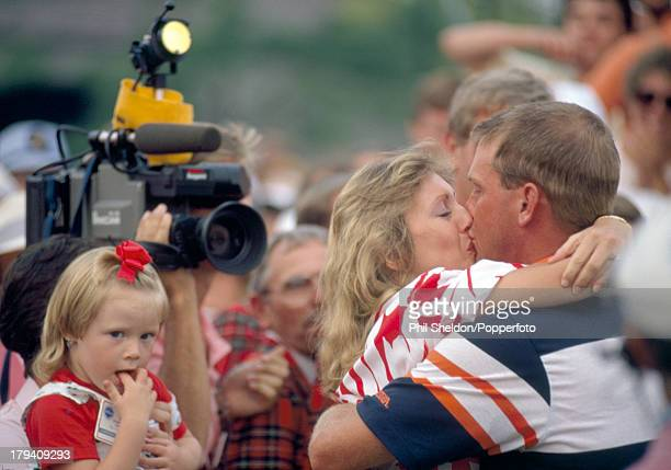 Payne Stewart of the United States kisses his wife Tracey whilst his daughter Chelsea looks on after winning the US PGA Championship held at the...