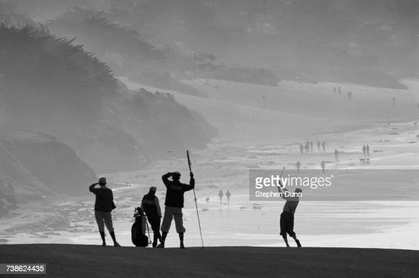 Payne Stewart of the United States wearing his plus fours is silhouetted against the oceanside backdrop as he plays from the ninth fairway during the...