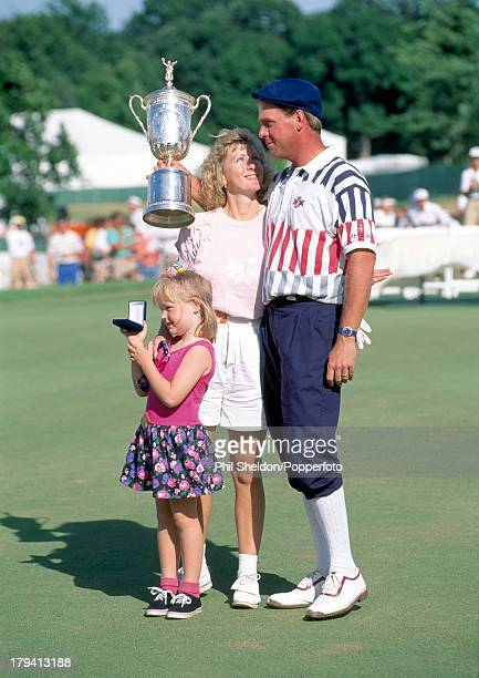 Payne Stewart of the United States, with his wife Tracey and daughter Chelsea, holds the trophy after winning the US Open Golf Championship held at...