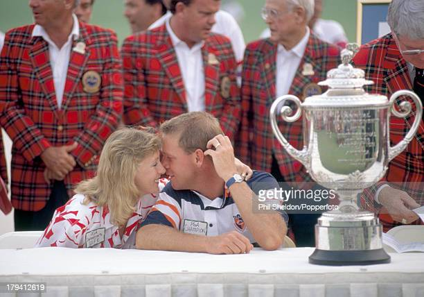 Payne Stewart of the United States with his wife Tracey and the trophy after winning the US PGA Championship held at the Kemper Lakes Golf Club in...