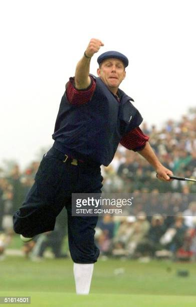 Payne Stewart of the US reacts to sinking his putt on the eighteenth green at Pinehurst No 2 during the final round of the US Open Championship 20...