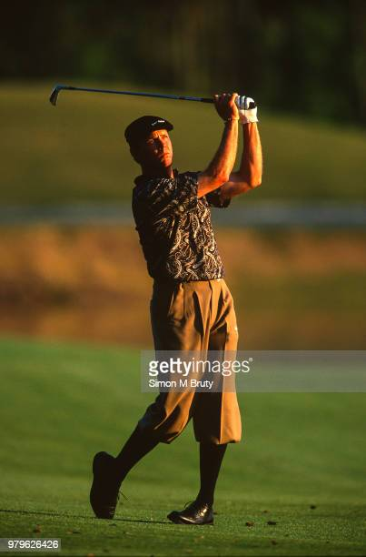 Payne Stewart of the USA hits a shot at the The Players Championship at the Tournament Players Club at TPC Sawgrass on March 28th 1998 in Ponte Vedra...