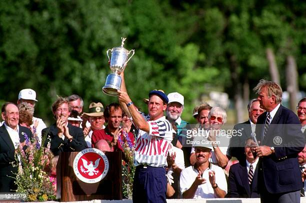 Payne Stewart of the USA holds the trophy aloft after winning the US Open at Hazeltine National Golf Club in Minneapolis Minnesota USA Mandatory...