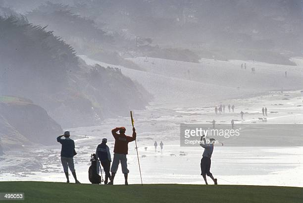 Payne Stewart of the USA in silhouette against the oceanside backdrop plays from the ninth fairway during the 1991 ATT Pebble Beach ProAm on 1...