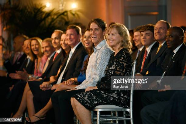 Payne Stewart's family, wife, Tracey and son Aaron, laugh at the Payne Stewart Award ceremony prior to TOUR Championship at The Ritz Carlton on...