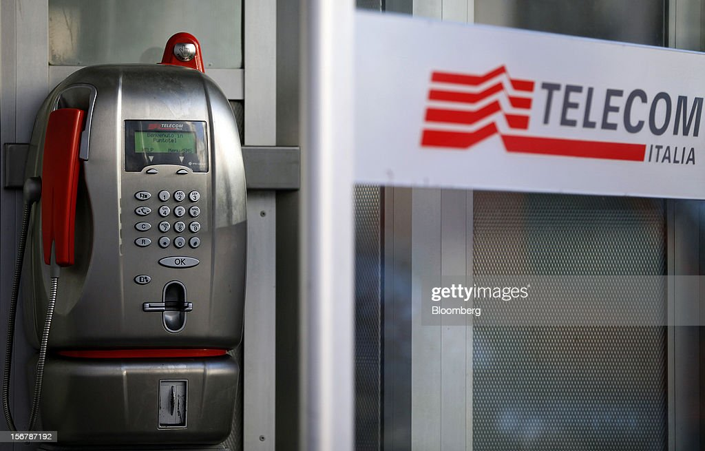 A payphone operated by Telecom Italia SpA is seen inside a public telephone booth in Milan, Italy, on Tuesday, Nov. 20, 2012. Telecom Italia SpA said it is still reviewing the possible spinoff of its fixed-line network and the company's board will discuss the outcome of its analysis on Dec. 6. Photographer: Alessia Pierdomenico/Bloomberg via Getty Images