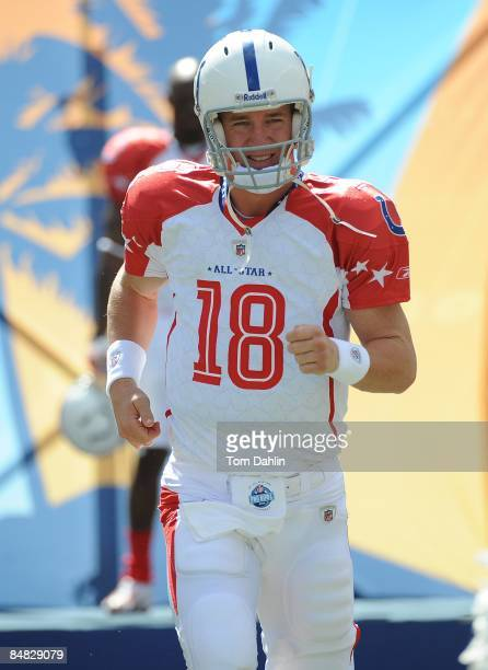 Payton Manning of the Indianapolis Colts runs onto the field during AFC pregame introductions before the NFL Pro Bowl in Aloha Stadium on February 8...