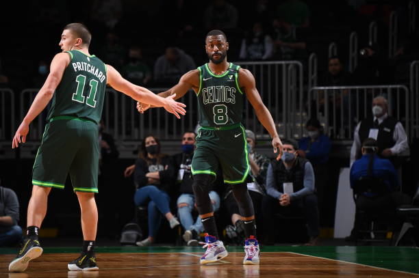 Payton Pritchard and Kemba Walker of the Boston Celtics hi-five during the game against the Dallas Mavericks on March 31, 2021 at the TD Garden in...