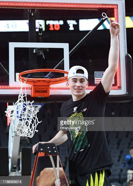 Payton Pritchard of the Oregon Ducks celebrates after cutting down a net following the team's 68-48 victory over the Washington Huskies to win the...