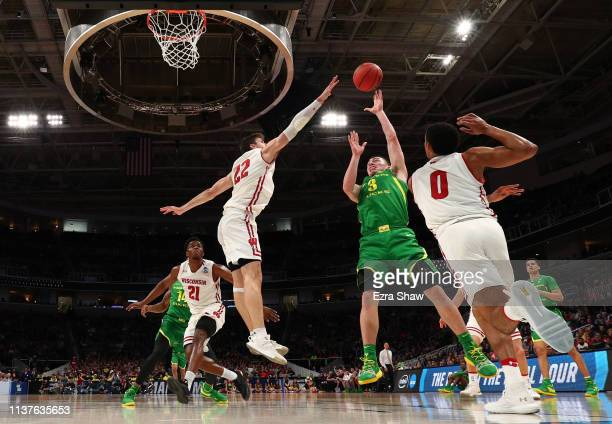 Payton Pritchard of the Oregon Ducks takes a shot against Ethan Happ of the Wisconsin Badgers in the first half during the first round of the 2019...