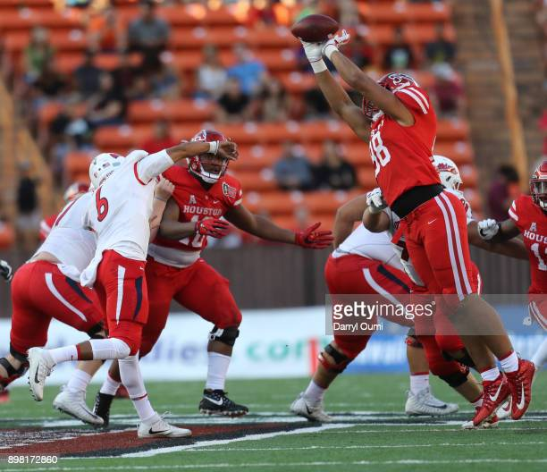 Payton Turner of the Houston Cougars blocks the pass off the arm of Anthoula Kelly of the Fresno State Bulldogs during the second quarter of the...