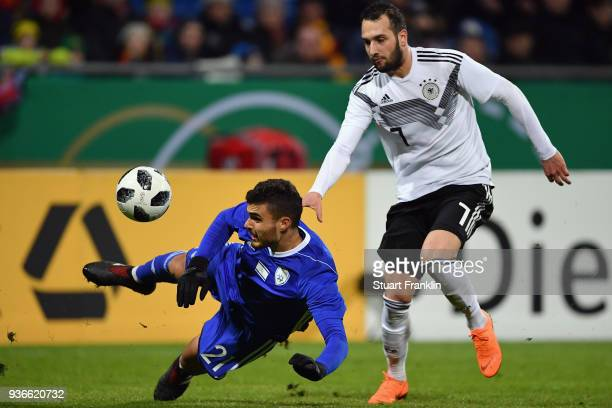 Paz Ben Ari of Israel is challenged by Levin Oeztunali of Germany during the 2019 UEFA Under21 European Championship qualifier match between U21...
