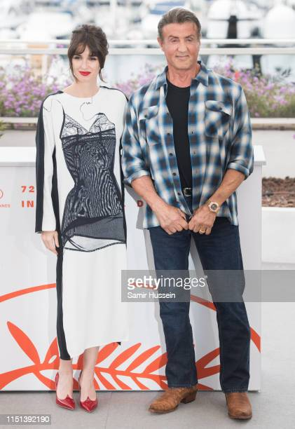 Paz Vega and Sylvester Stallone attend the photocall for Sylvester Stallone Rambo V Last Blood during the 72nd annual Cannes Film Festival on May 24...