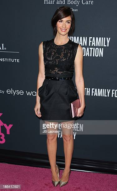 Paz Vega attends Elyse Walker Presents The Pink Party 2013 hosted by Anne Hathaway at The Barker Hanger on October 19 2013 in Santa Monica California