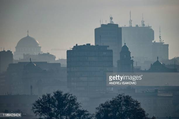 Pciture taken on December 18, 2019 shows buildings and churches, as heavy fog and air pollution dominate the sky over Serbian capital Belgrade. - A...