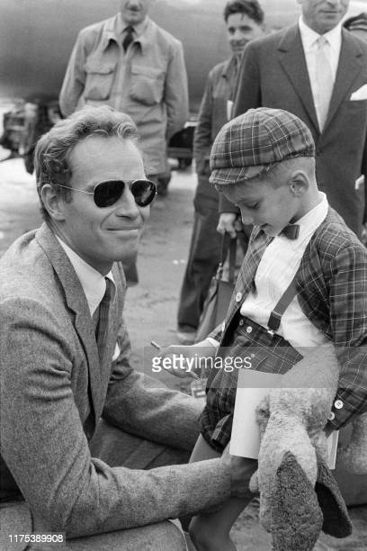 Pïcture taken on October 6 1960 at Orly airport showing American actor Charlton Heston welcoming his son Fraser arriving to meet his father before...