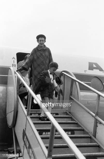 Pïcture taken on October 6 1960 at Orly airport showing Charlton Heston's wife Lydia Klarke and his son Fraser arriving to meet Charlton heston...