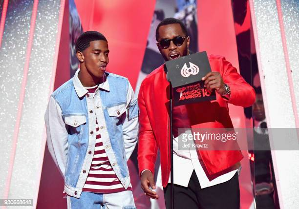 Diddy and Christian Combs speak onstage during the 2018 iHeartRadio Music Awards which broadcasted live on TBS TNT and truTV at The Forum on March 11...